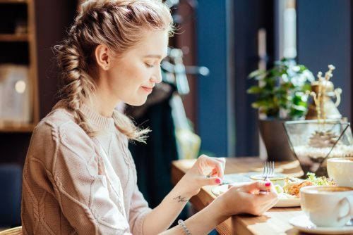 Close,Up,Image,Of,Hungry,Blond,Woman,Eating,Classic,Breakfast